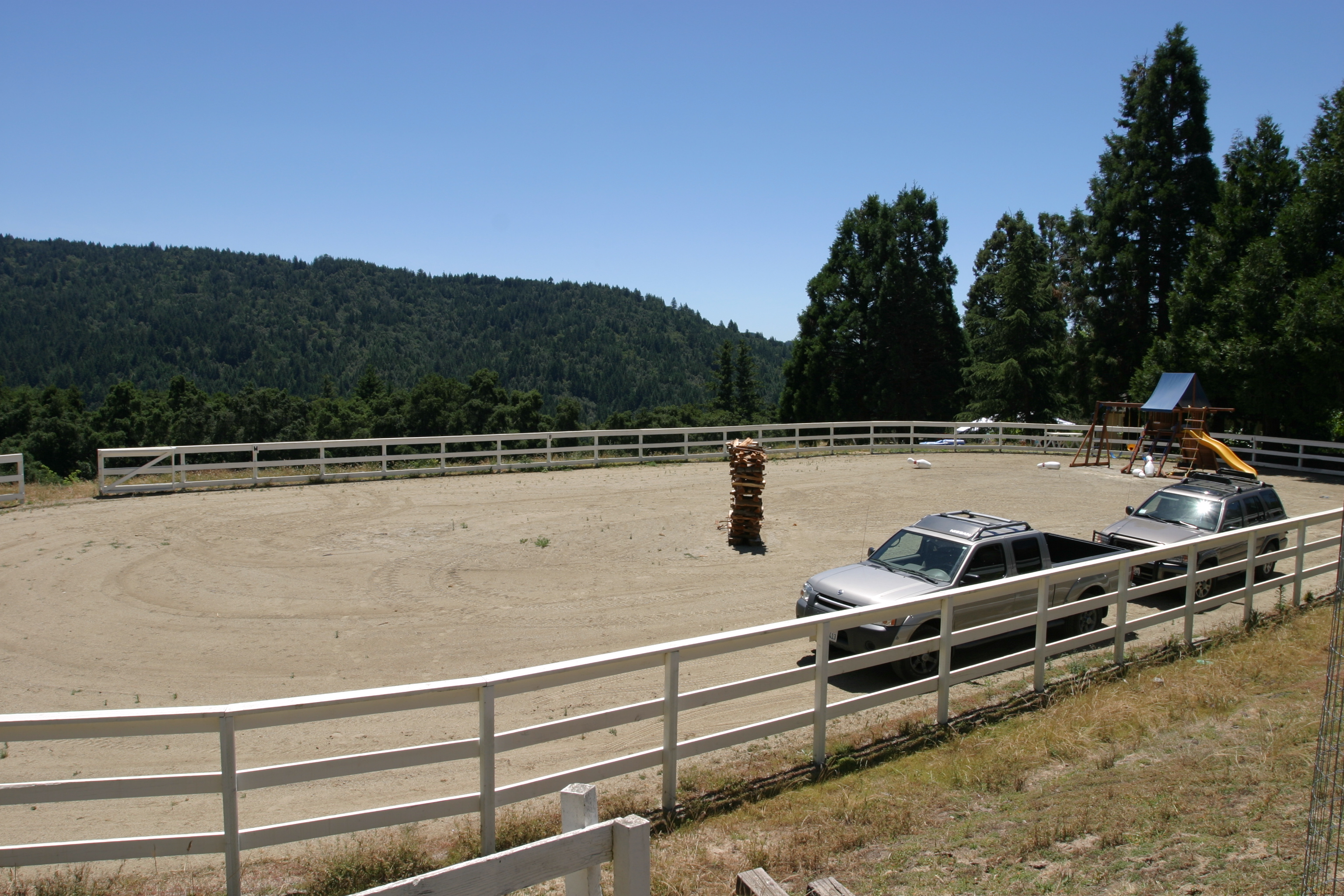 Horse arena and parked cars